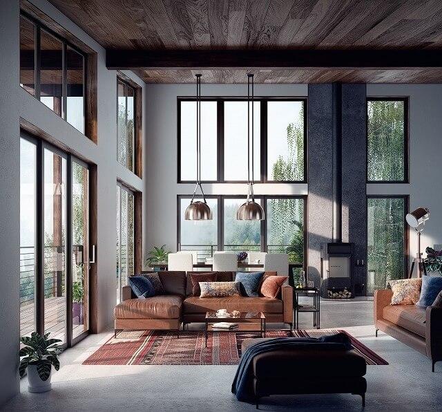 この素朴なリビングルームには窓や魅力がありません。その茶色の革のソファは、エレガントでありながら男性的なカリスマに満ちているデザインを作成するために自由奔放に生きるように動かされた敷物と木製のパネル張りの天井によって完全に相殺されます。