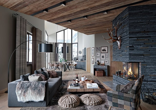 この素朴なリビングルームに入ると、あなたはコテージとモダンな装飾のきめ細かいミックスで迎えられます。このレイアウトの素朴な魅力は、レンガや木のような大きな要素だけでなく、ファースローやマウントされた角のような小さな要素によっても可能になります。