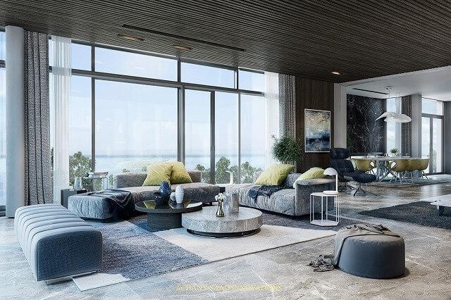 静かなブルースは、このリビングルームの窓のすぐ外側にある海の色を模しています。青い家具製造販売業は灰色の床の厳しさを落ち着かせ、木張りの天井から素晴らしく演じる。この全体のデザインは、超近代的なビーチハウスのようです。