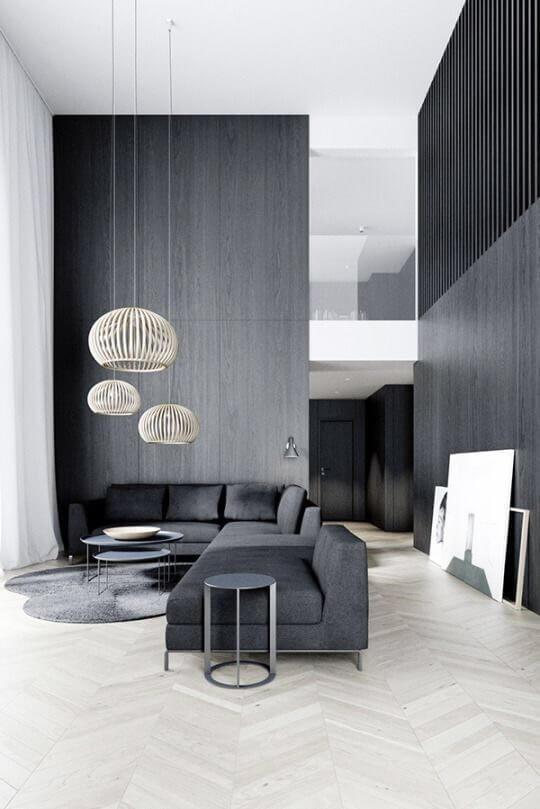 ヘリンボーンの白い床でソファーがダークグレーで壁面もダークグレー。かなりシンプルな印象。
