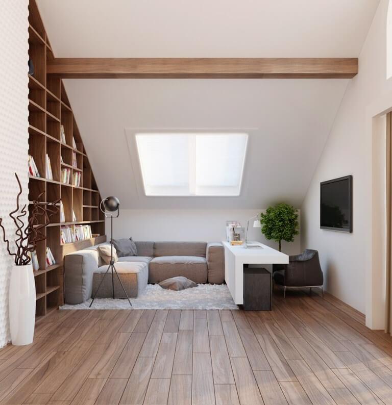 勾配天井でライトグレーのソファーを空間にぴったりのサイズで配置しています。横にある本棚も部屋の形に合わせて計算されて作られています。無駄な空間をできるだけ排除して合理性を持ってデザインされています。デスクも個性的ですね。