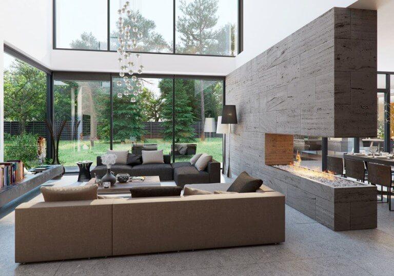 吹き抜けで窓ガラスが高い位置まで開放されている海外のインテリア事例。ソファーの横に埋め込みの暖炉がしつらえてあります。