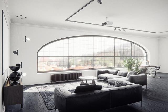 スタジオのアパートメントはすばらしいデザインの機会であり、その理由を見ることができます。ユニークな形の窓と都会の景色は、このデザイナーのモノクロームビジョンに最適なバックドロップを提供します。
