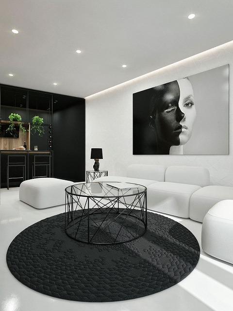 幾何学模様とモダンアートはこのすばらしい部屋を特徴づけています。黒、白、灰色は、部屋の美しさを和らげるための織りの敷物で、気持ちの良いブレンドです。ユニークなコーヒーテーブルの幾何学的デザインは部屋に次元を加え、緑豊かなハウスプラントは爽やかな色彩のバーストです。白いソファは、ほとんどバブルのようなもので、リラックスした場所のようです。